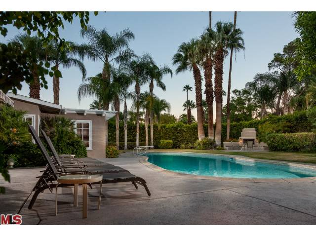 dinah shore's palm springs home had a 50ft long pool