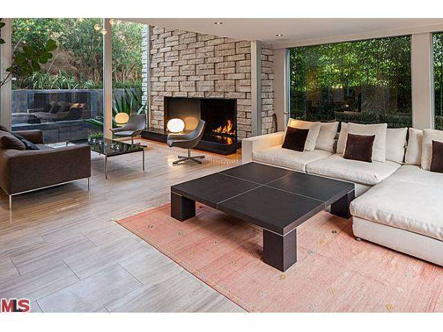 Living room with fireplace  of the Mid Century home owned by Meryl Streep in the Hollywood Hills