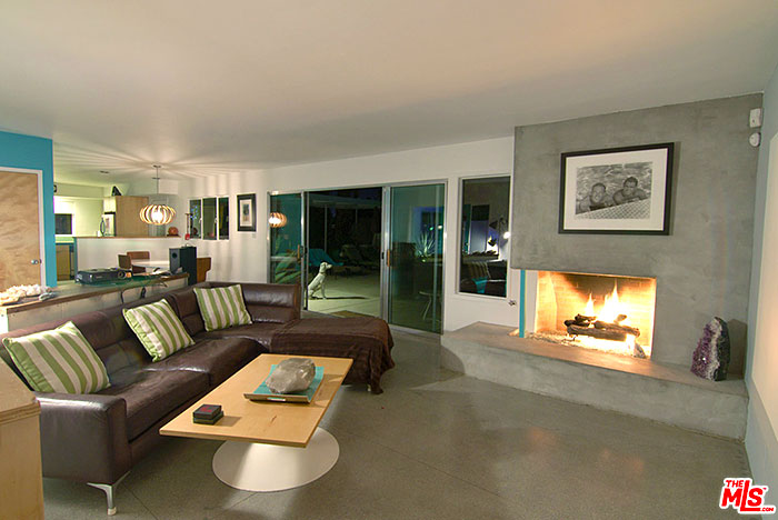Central palm springs sunrise park mid-century modern vacation rental with large living room with polished concrete floors