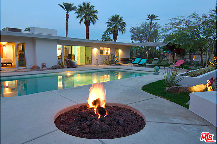 Palm Springs mid-century modern vacation rental in Sunrise Park has an oversized lot with swimming pool and fire feature.