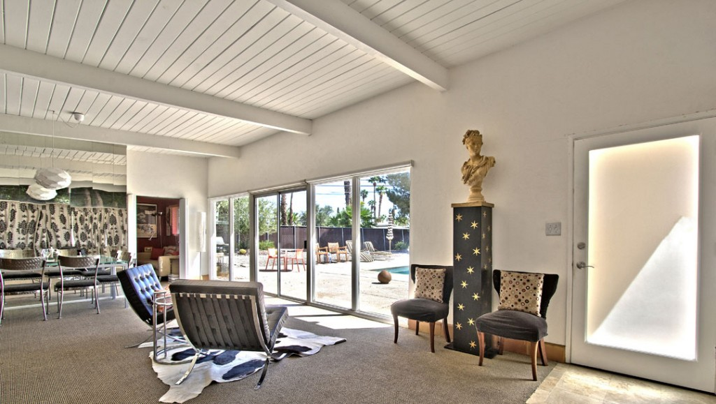 Jack Meiselman Mid-century modern living room with wall of glass onto yard
