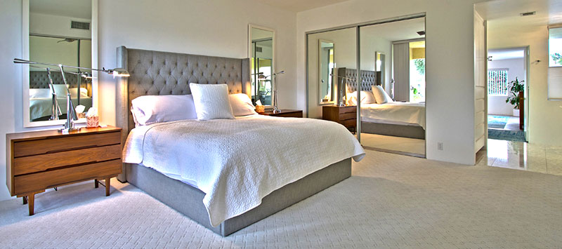 Master bedroom of a seven lakes country club mid-century modern condo