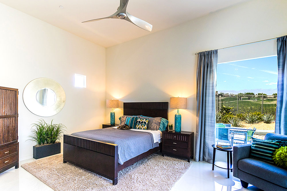 Large master bedroom with views of golf course and mountains